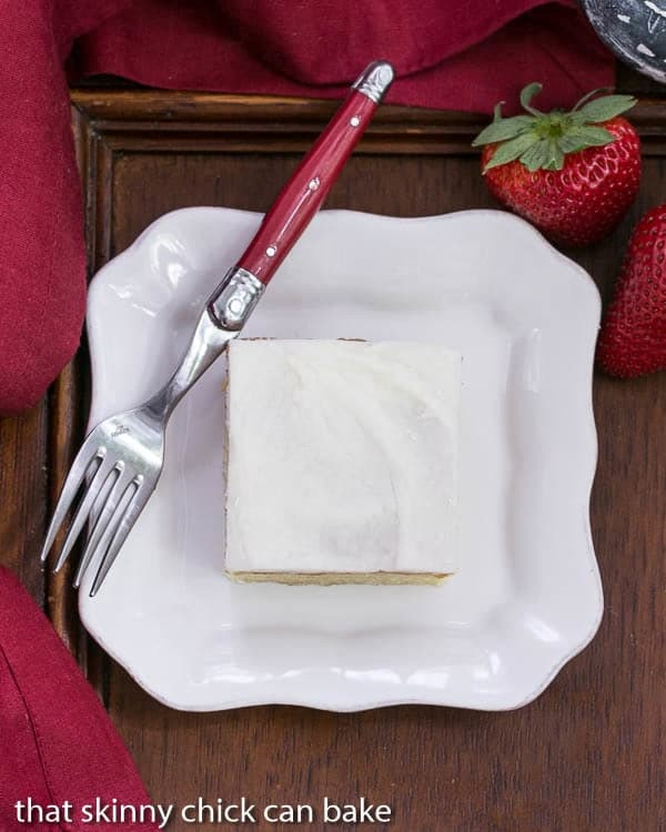 White Sheet Cake slice overhead shot on white plate