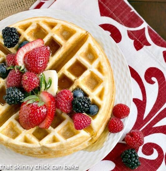 Homemade Buttermilk Waffles on a white plate with berries