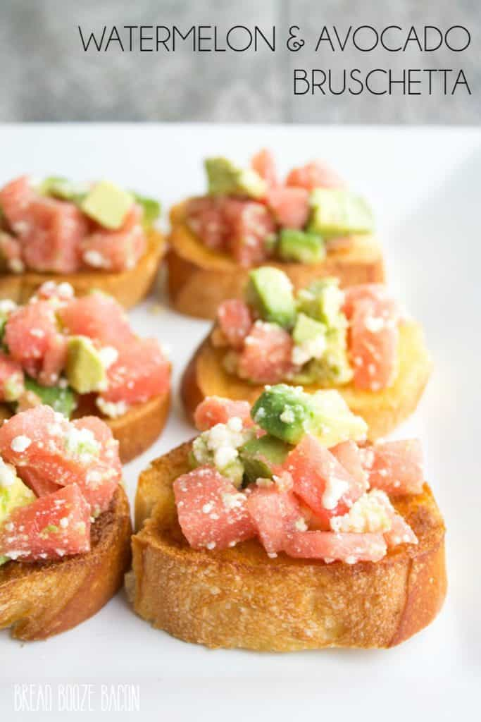 Watermelon Avocado Bruschetta lined up on a white tray