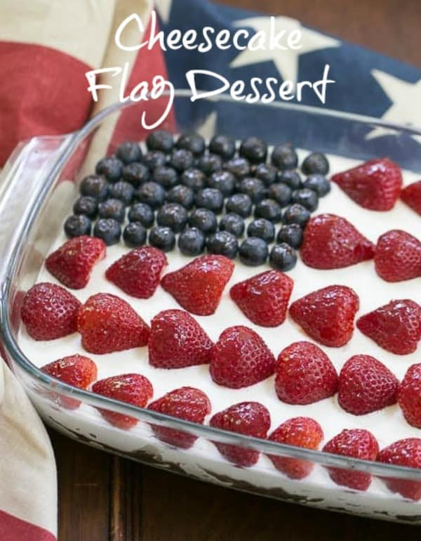 Berry Cheesecake Flag Dessert - Shortbread crust covered with a light whipped cheesecake filling, then decked out like the American flag with luscious, ripe berries! #cheesecake #flagdessert #berryflag #patrioticdessert