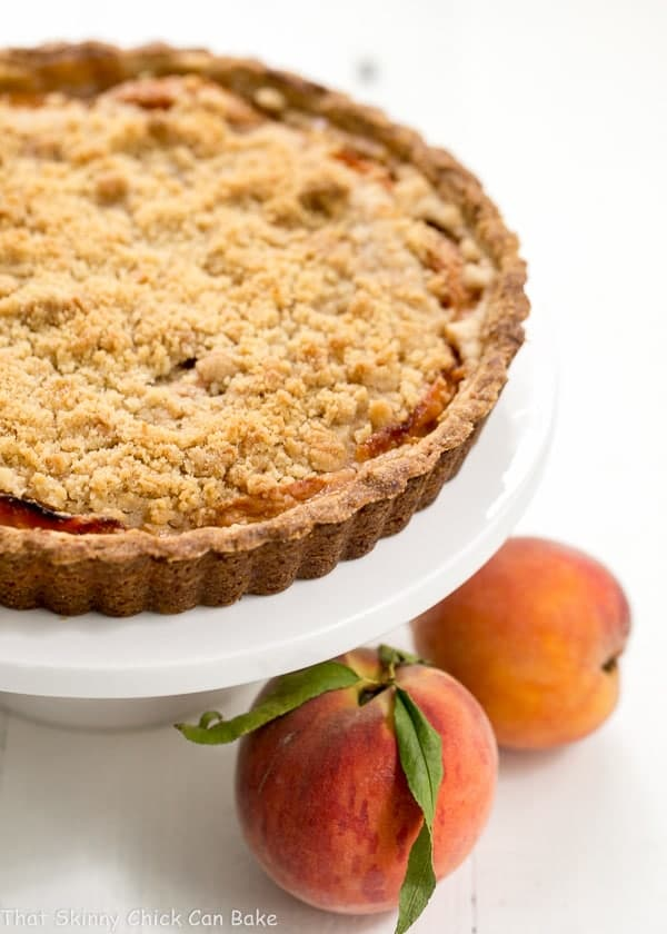 Streusel Topped Peach Tart - A sweet crust, fresh peaches and buttery streusel make for a fabulous summer dessert!