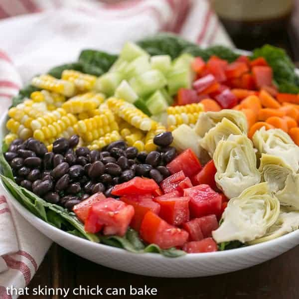 Summer Vegetable Salad | Spinach topped with a vibrant rainbow of toppings