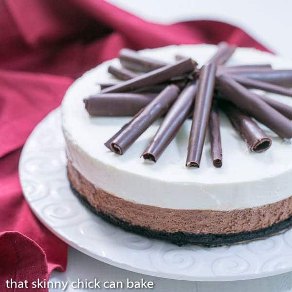 Triple Chocolate Mousse Pie on a white serving plate with a red napkin