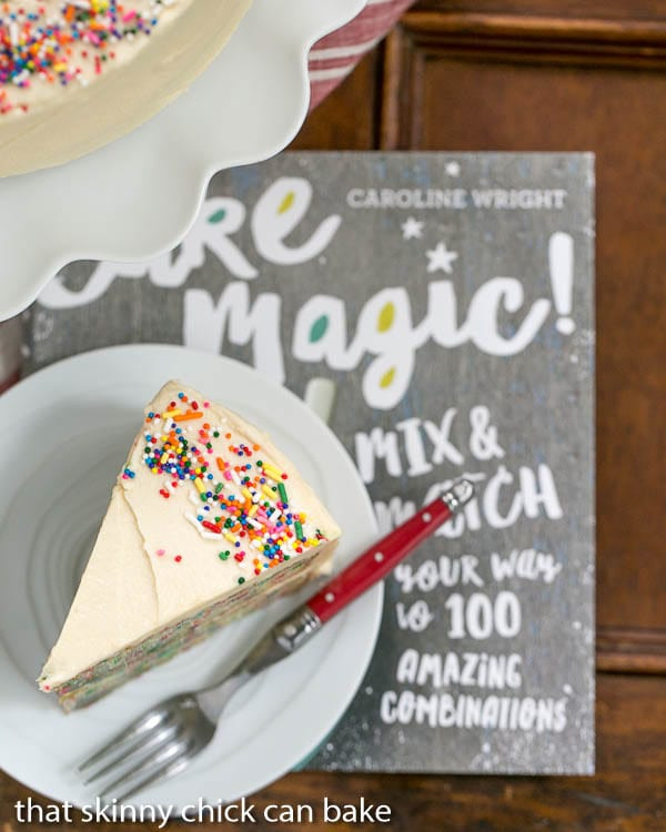 Festive Confetti Layer Cake - A moist vanilla cake doused in vanilla syrup and iced with a delectable vanilla malt frosting!