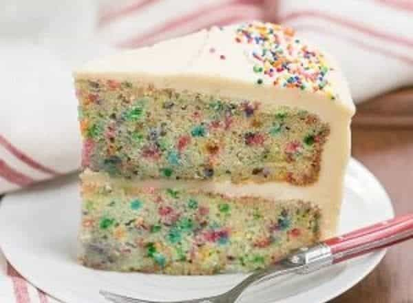 Confetti Cake   A moist vanilla cake doused in vanilla syrup and iced with a delectable vanilla malt frosting!