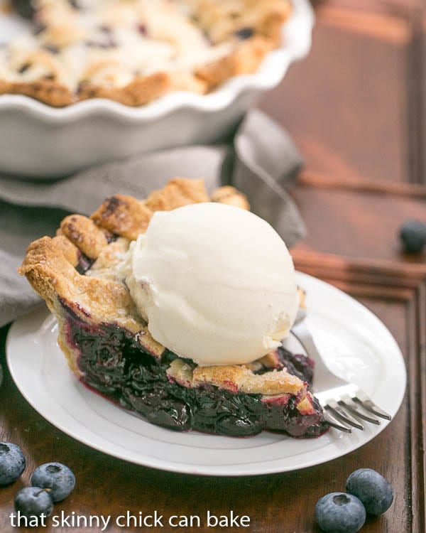 Slice of a Freeze and Bake Blueberry Pie topped with ice cream