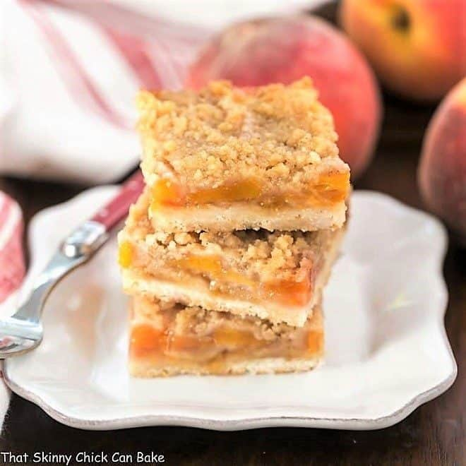 Fresh Peach Pie Bars stacked on a square white plate