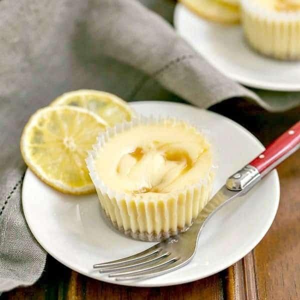 Lemon Curd Mini Cheesecakes | Individual vanilla cheesecakes swirled with lemon curd