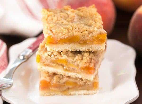 Peach Pie Bars | A shortbread crust topped with sweetened peaches and a streusel topping!