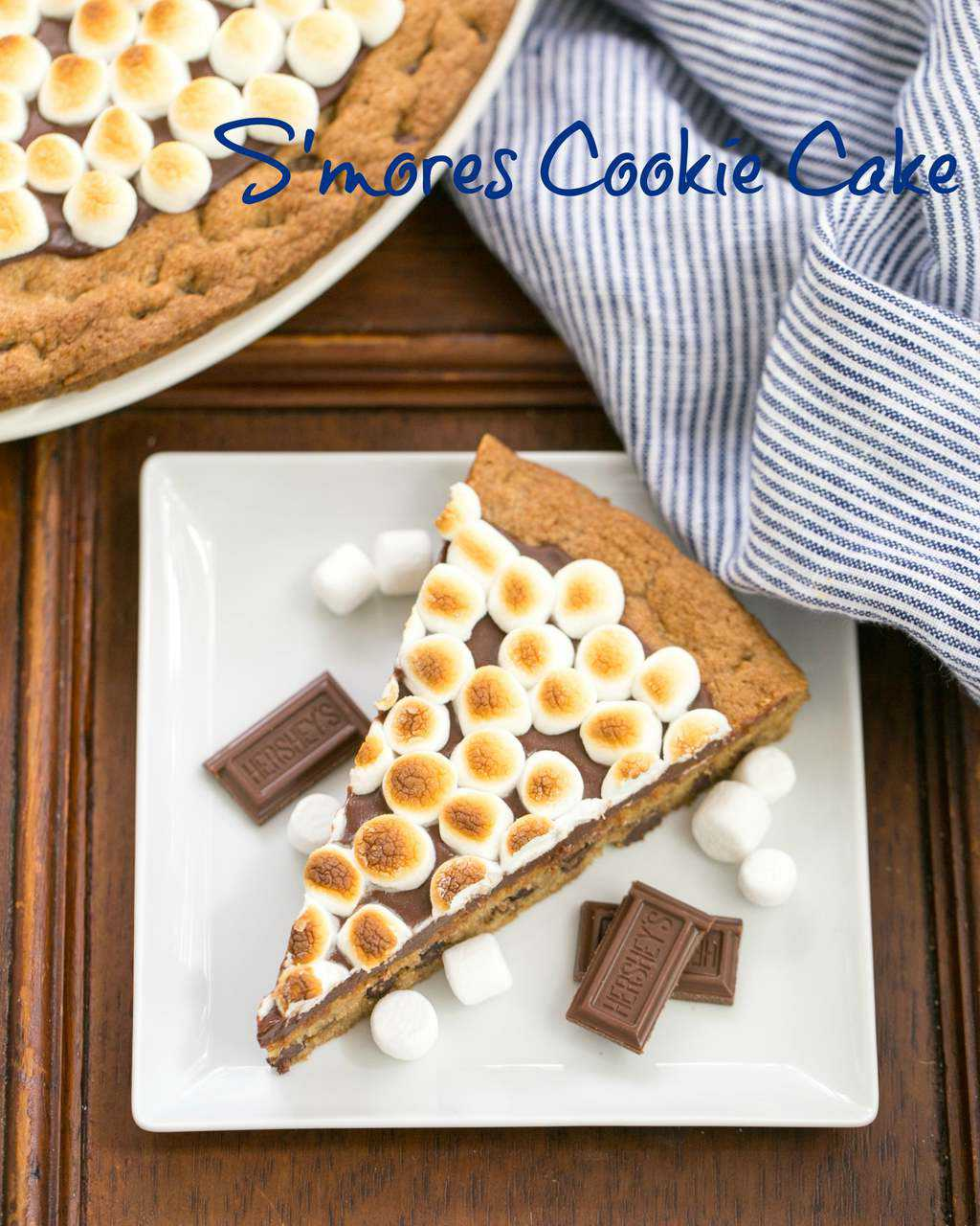 S'mores Cookie Cake - A tasty riff on the classic campfire treat! #smores #cookiecake #picnicdessert #summerdessert