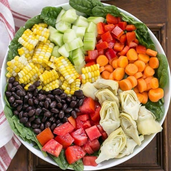 Summer Vegetable Salad - Spinach topped with a vibrant rainbow of toppings