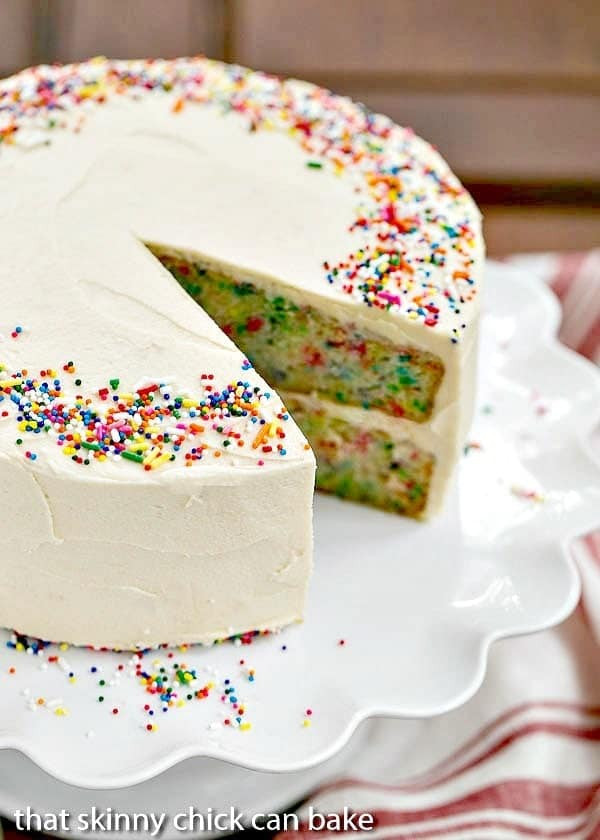 Confetti Cake | A moist vanilla cake doused in vanilla syrup and iced with a delectable vanilla malt frosting!