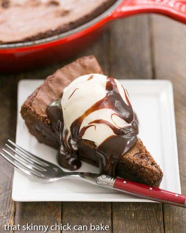 Fudgy Skillet Brownies served with a scoop of vanilla ice cream