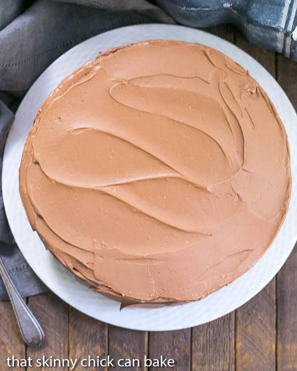Overhead view of a Mocha Layer Cake on a white plate
