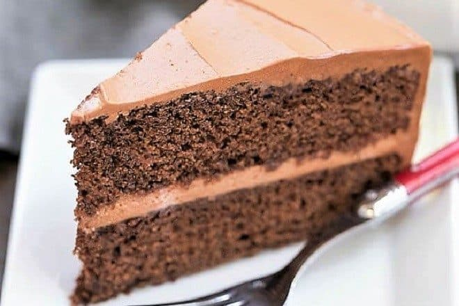 Mocha Layer Cake slice on a white plate