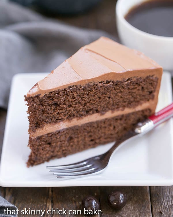 Mocha Layer Cake - Filled with a Kahula Milk Chocolate Mousse and iced with a luscious chocolate Swiss meringue buttercream!