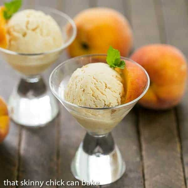 No Churn Roasted Peach Ice Cream in martini glasses with sprigs of mint
