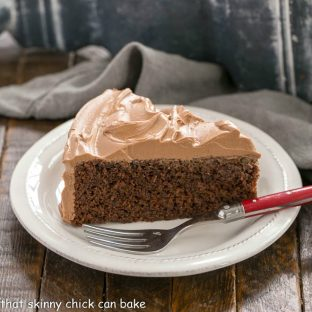 One Layer Mocha Cake on a white plate with a red handled fork