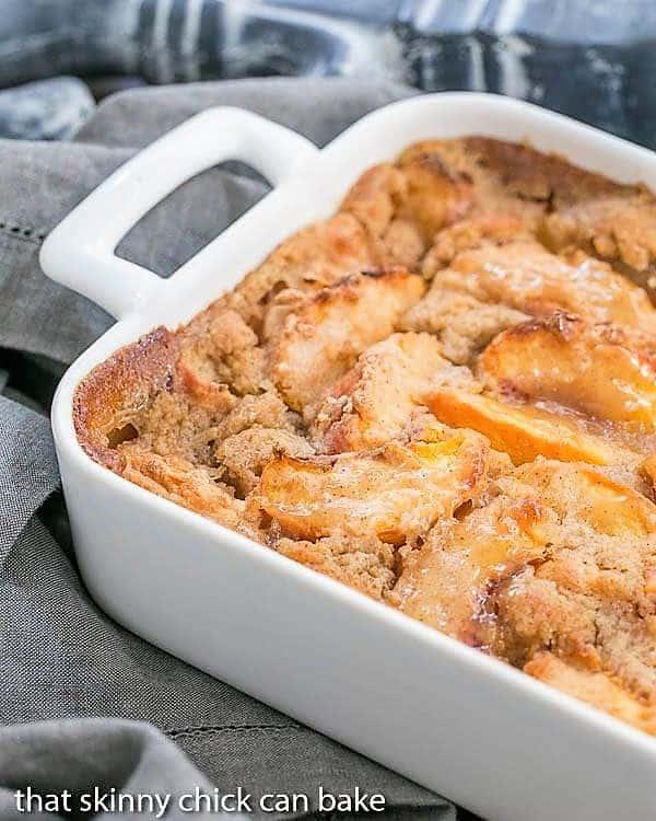 Fresh Peach Pudding partial view in a white ceramic casserole
