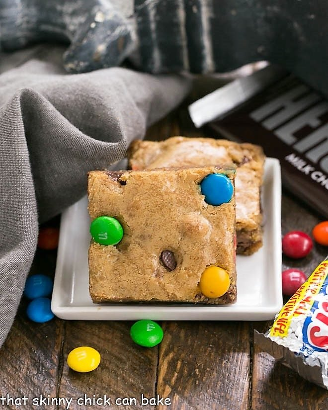 Candy Bar Blondies on a square white plate