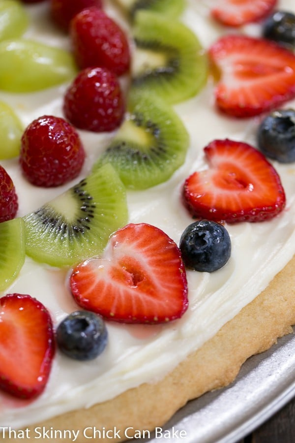 Fresh Fruit Pizza | A vibrant, delicious dessert pizza with a sugar cookie crust and cream cheese frosting!
