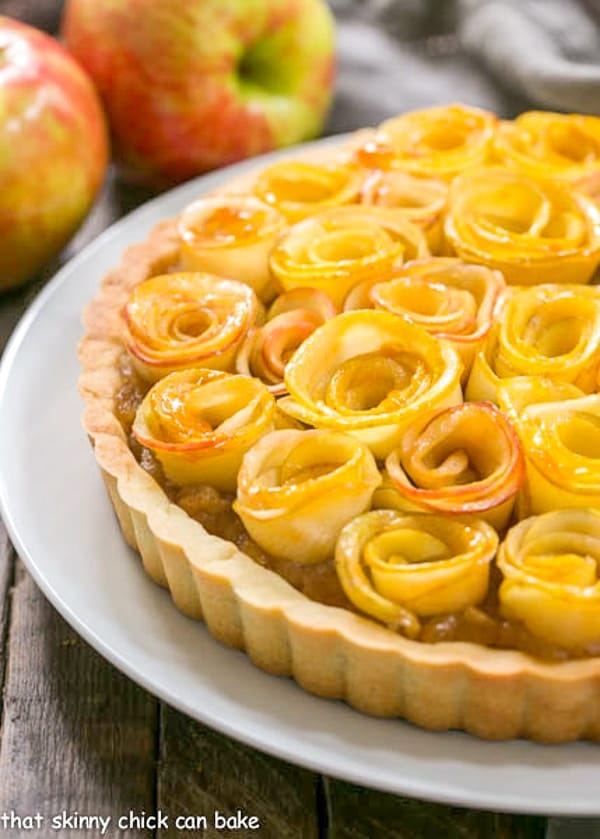 Rose Apple Tart | A buttery crust filled with cinnamon spiced applesauce and topped with apple roses