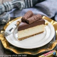 Twix cheesecake slice on a white plate