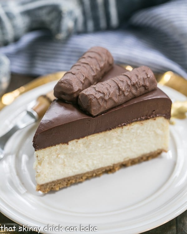 A slice of Twix Cheesecake on a white plate