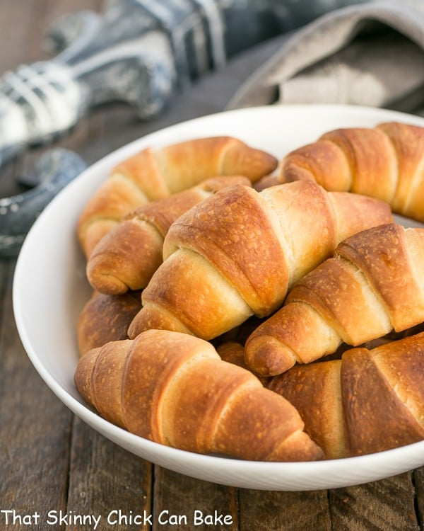 Buttery Homemade Crescent Rolls in a white serving bowl