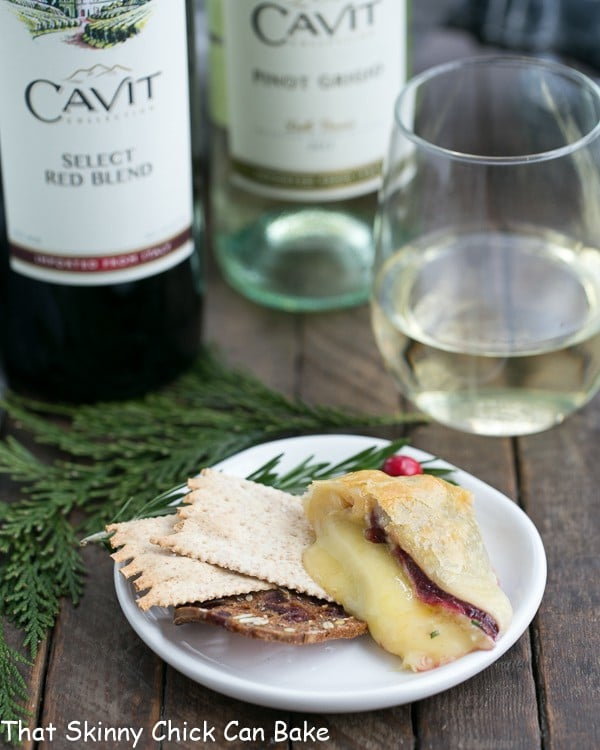 Cranberry Brie en Croute slice on a small appetizer plate with crackers