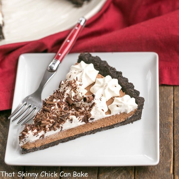 French Silk Tart slice on a square white plate with a red fork