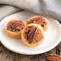 Pecan Tassies on a round white plate