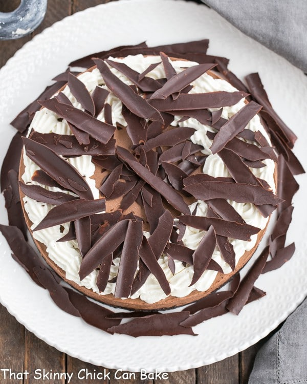 How to Make Chocolate Shards topping this Easy Chocolate Mousse Cake on a white dessert plate