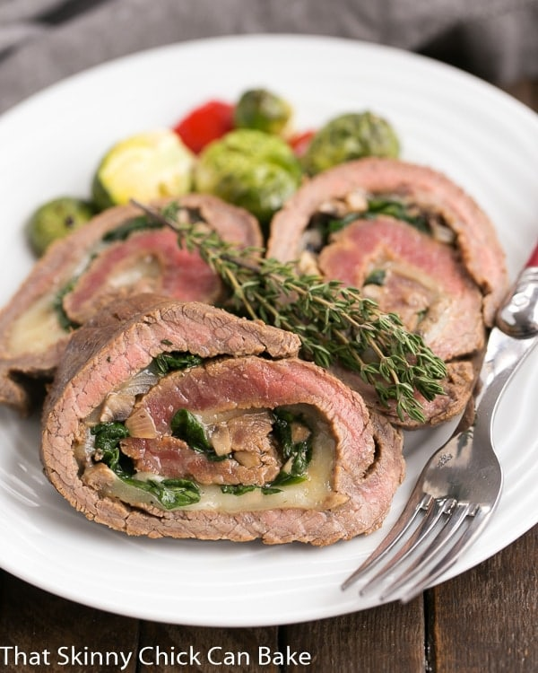 Flank Steak Roulades | A butterflied steak filled with spinach, mushrooms and Provolone cheese