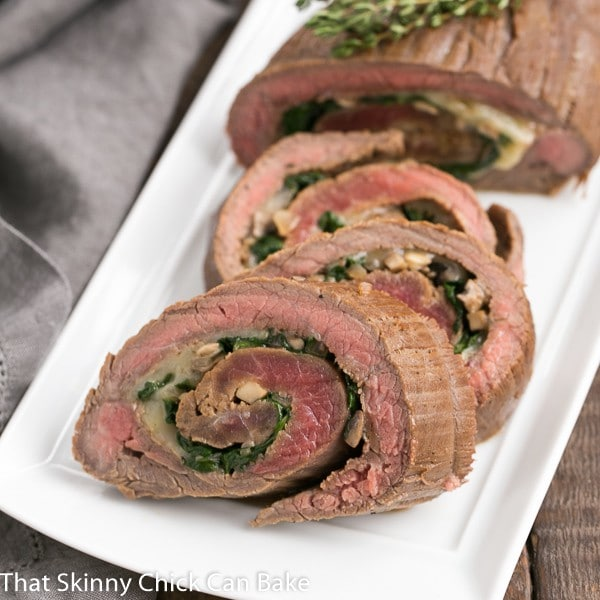 Flank Steak Roulades  on a white rectangular tray