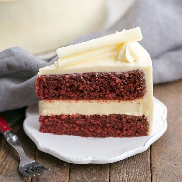 Cheesecake Filled Red Velvet Cake | A sublime combination of red velvet cake, cheesecake and cream cheese frosting!
