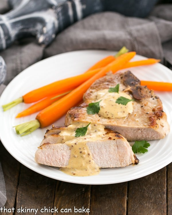 Pork Chops Dijonnaise on a white plate with carrots