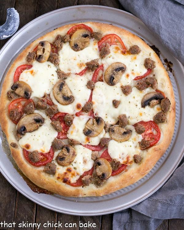 )verhead view of Sausage Mushroom Pizza