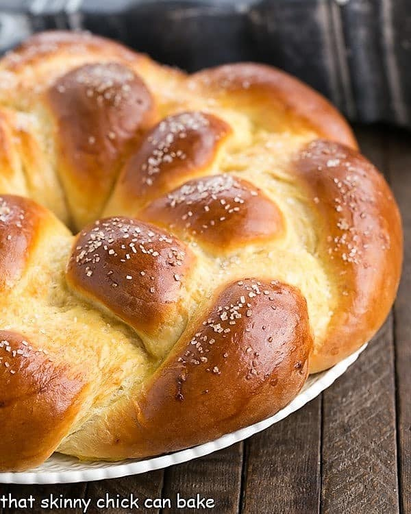 photo shows half of a loaf of Braided Easter Bread on a white platter