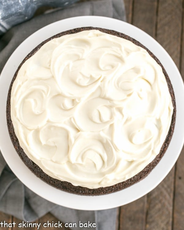 overhead image of a cream cheese frosted Guinness infused chocolate cake
