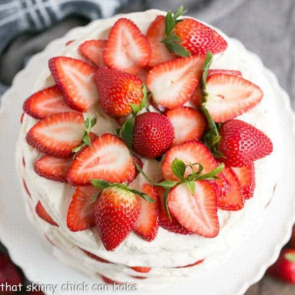 overhead photo of a fresh strawberry meringue layer cake