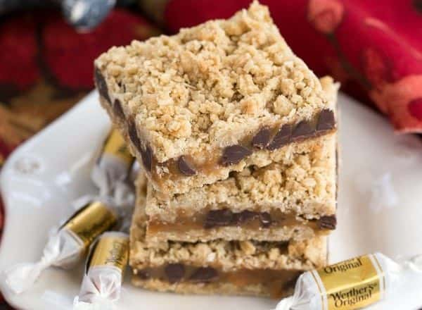 white dessert plate with stacked Oatmeal Caramel Bars