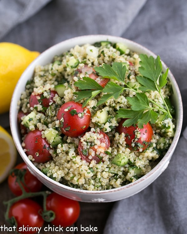 overhead photo of a white bowl filled with tabbouleh, made with quinoa instead of bulgar