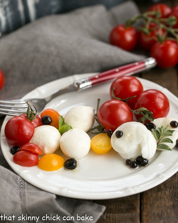 Burrata Caprese Salad with Balsamic Pearls | Burrata and gelled balsamic vinegar push this salad over the top!