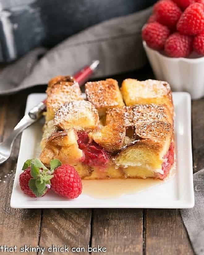 Raspberry Mascarpone French Toast Casserole slice on a square white plate