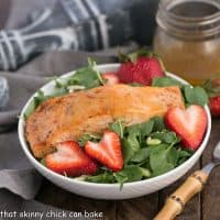 Salmon Watercress Salad with Strawberry Vinaigrette | Tender, peppery greens tossed with a berry vinaigrette and topped with roasted salmon