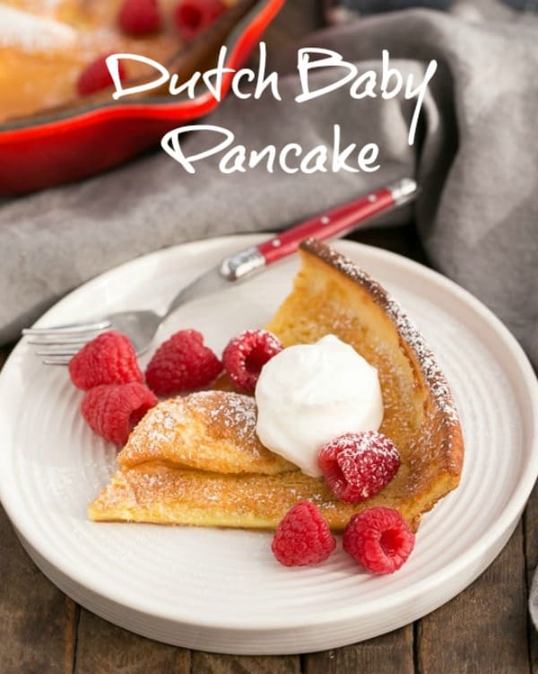 Best Dutch Baby Pancake - A puffed breakfast dish topped with berries, whipped cream and powdered sugar! #breakfast #brunch #pancake #MothersDay #dutchbaby
