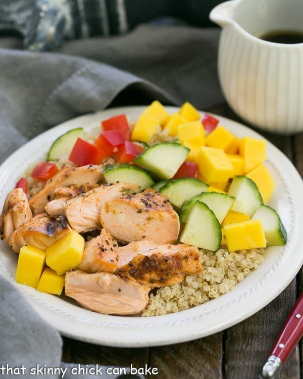 Caribbean Salmon Quinoa Salad   Perfectly portioned, healthy salad with quinoa, mangoes, jerk seasoned salmon and vegetables!