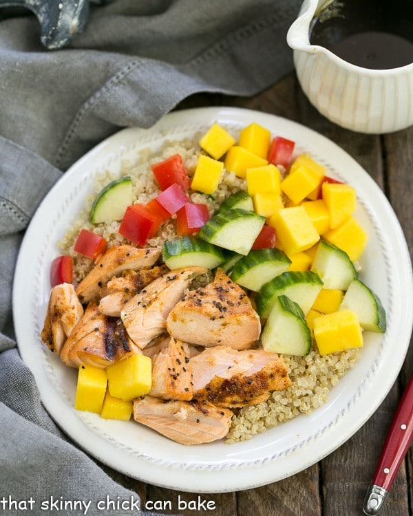 Caribbean Salmon Quinoa Salad | Perfectly portioned, healthy salad with quinoa, mangoes, jerk seasoned salmon and vegetables!