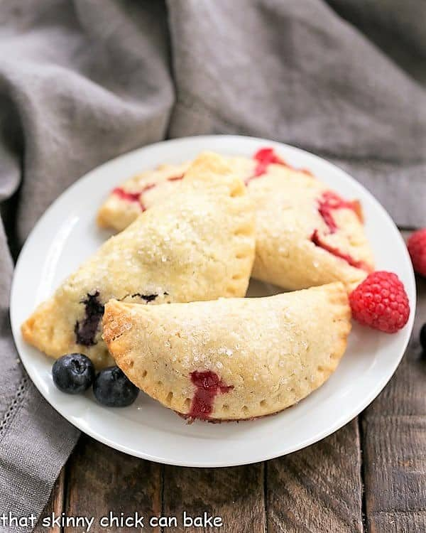 Rustic Berry Turnovers on a round white plate